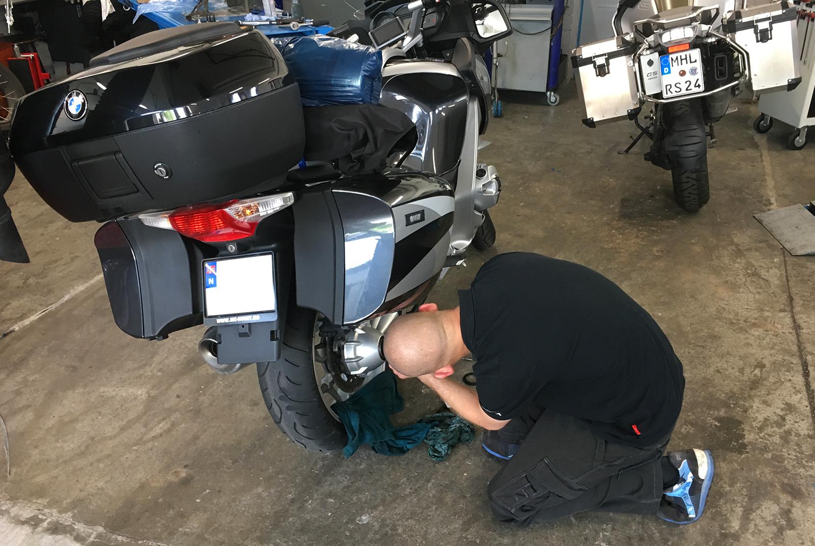 A skilled BMW technician analyzing the problem