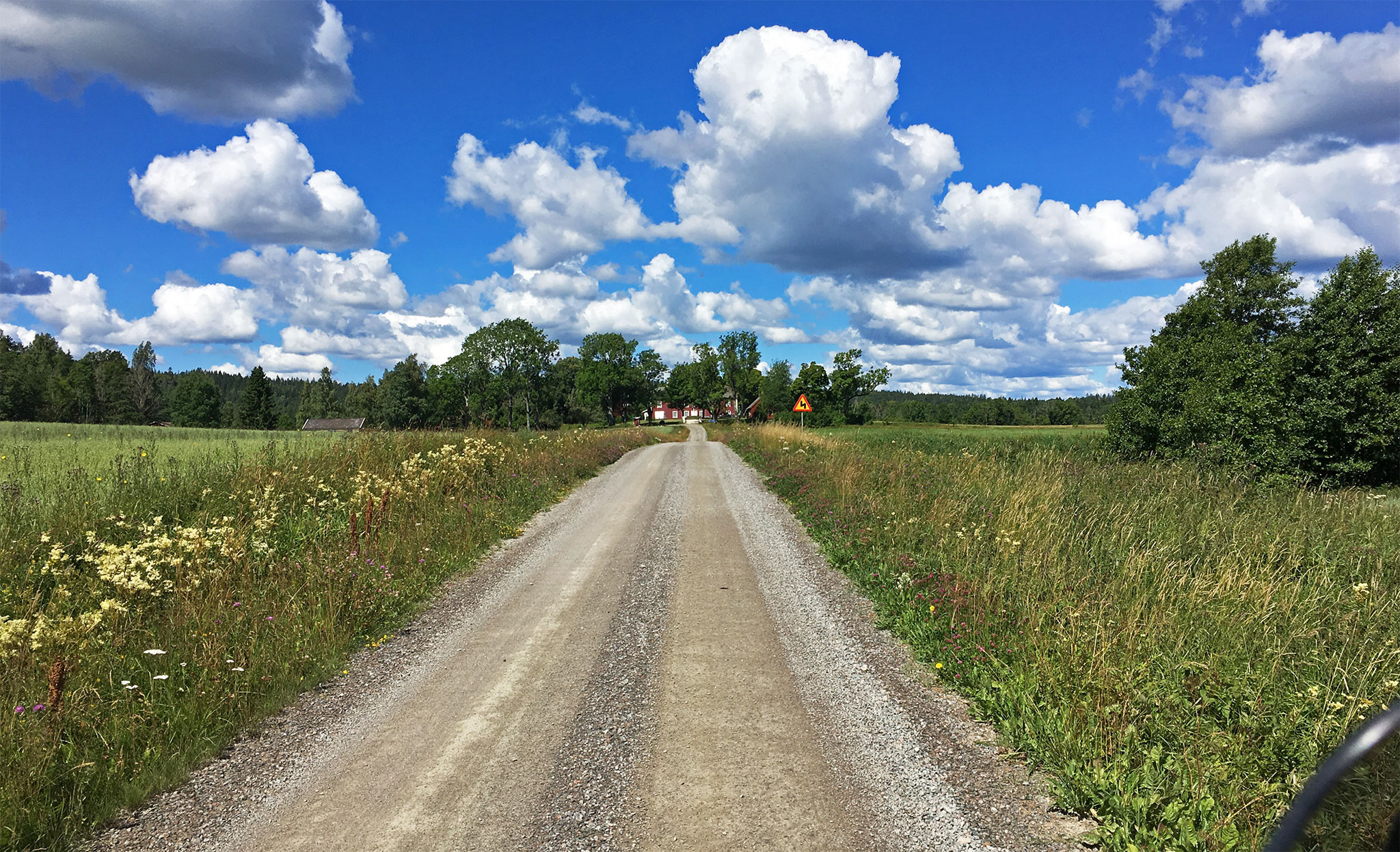 Swedish countryside seen from backroads, here on gravel which my bike handles very well even with luggage.